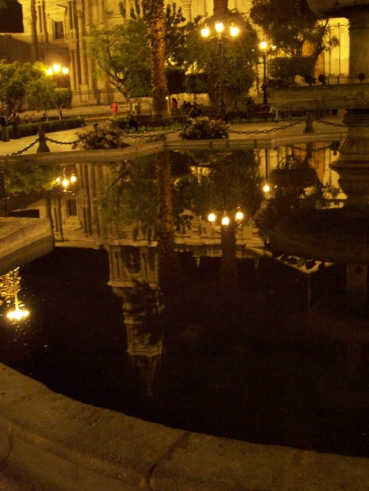 Reflections in water, Plaza De Armas, Arequipa, Peru