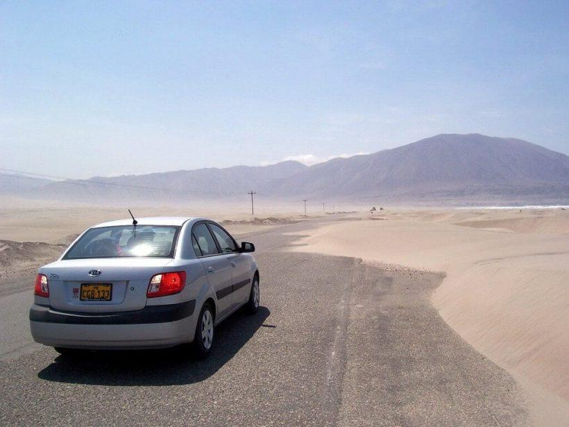 Sanddunes partially block pan american highway - peru - frame to frame