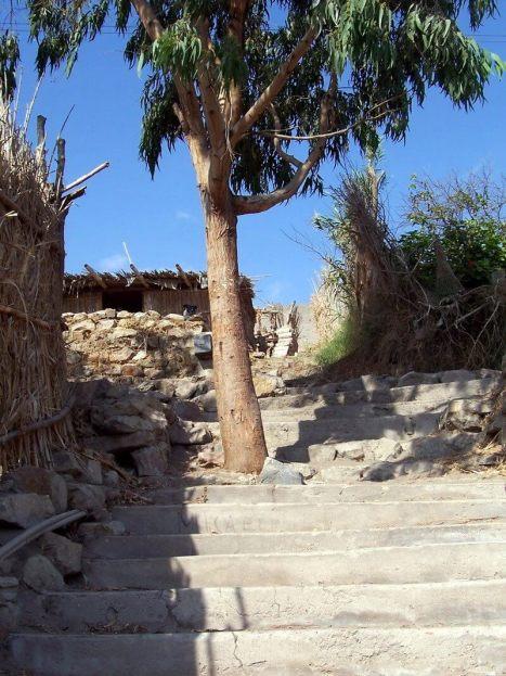 stone steps in sand dune village - camana - peru
