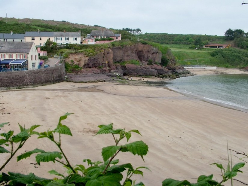 a sandy beach in dunmore east in county waterford - ireland