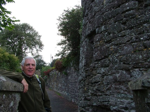 bob stands along a stone laneway in dunmore east in county waterford - ireland