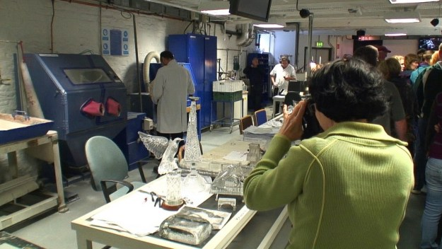 An image of Jean taking picture of various crystal objects at the Waterford Crystal factory in Waterford, Ireland