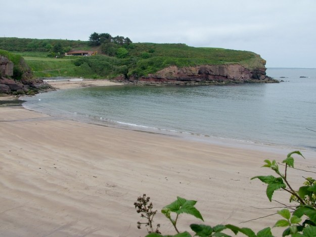 the beach along the strand at dunmore east in county waterford - ireland