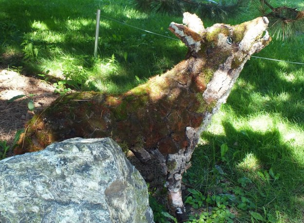 Wolf created out of wood at Montreal Botanical Gardens - Frame To Frame Bob & Jean