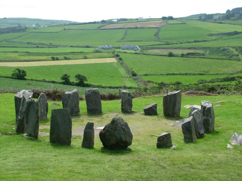 An image of the Drombeg Stone Circle with farm fields on the horizon in Ireland. Photography by Frame To Frame - Bob and Jean