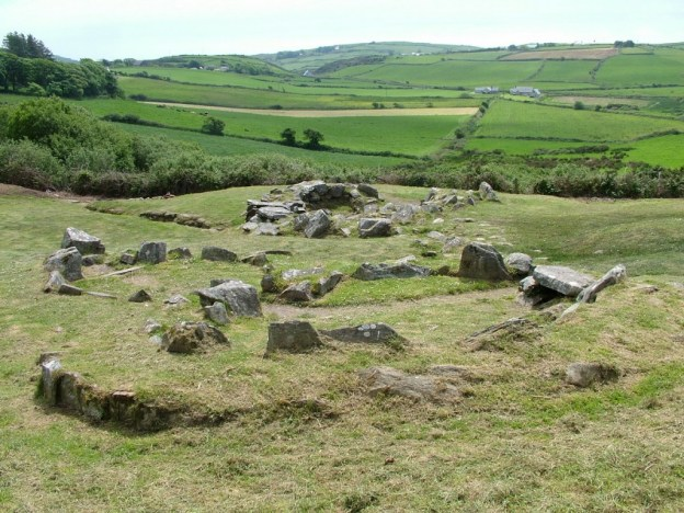 An image of the prehistoric ruins at the Fulacht Fiadh beside the Drombeg Stone Circle in County Cork, Ireland.  Photography by Frame To Frame - Bob and Jean