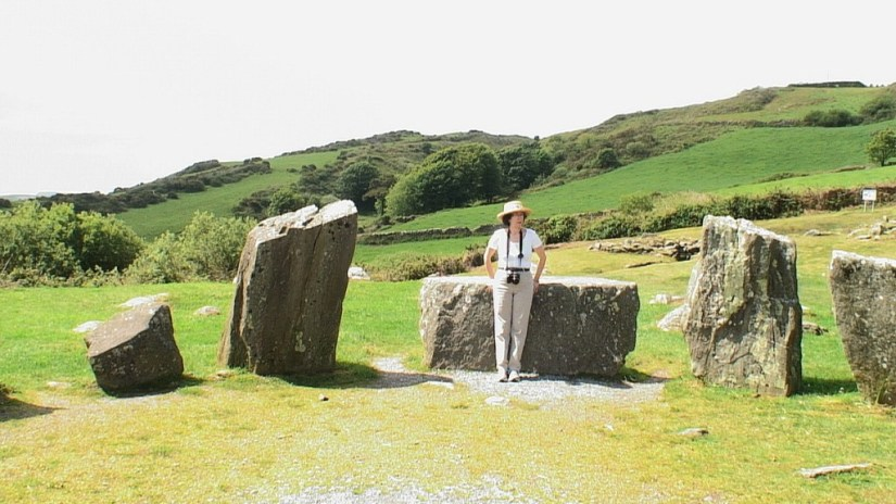 Jean leans againt the axial stone at the Drombeg Stone Circle in County Cork, Ireland.