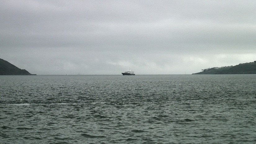 titanic's last anchorage spot, middle of picture where launch boat is located, off cobh town, county cork, ireland