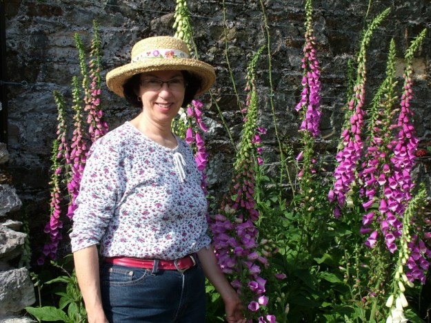 Jean standing beside Foxglove which is growing in a flower garden at Blarney Castle in County Cork, Ireland