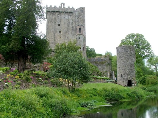 blarney castle, stream flowing by lawn and towers