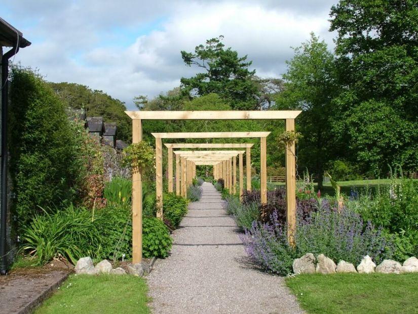 Flower gardens and walkway at Blarney Castle in County Cork, Ireland