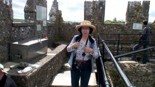 jean arrives at the blarney stone, blarney castle, ireland