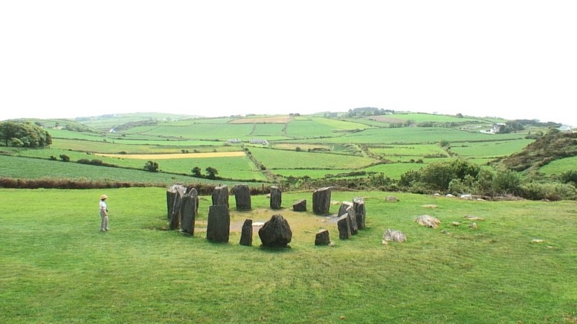 An image of Jean standing beside the Drombeg Stone Circle near Glandore in County Cork in Ireland. Photography by Frame To Frame - Bob and Jean.