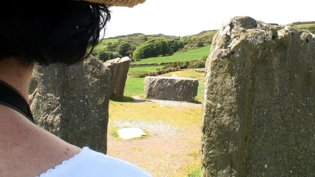 Jean looks at the recumbent axial stone at the Drombeg Stone Circle in County Cork, Ireland.