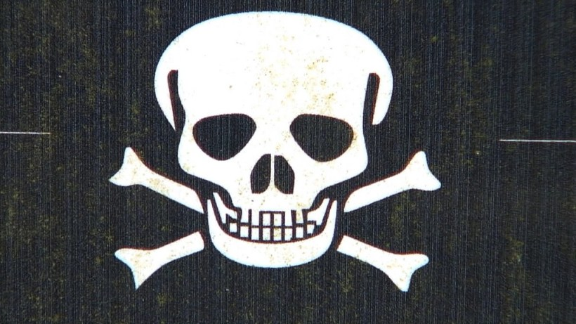 An image of a skull and cross bones symbol sign in the Poison Garden at Blarney Castle in County Cork, Ireland. Photograph by Frame To Frame - Bob and Jean County Cork, Ireland