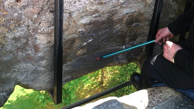 the blarney stone pointed out, blarney castle, ireland