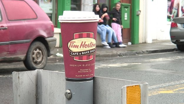 Tim Hortons coffee cup on metal post in Ennistymon, County Clare, Ireland