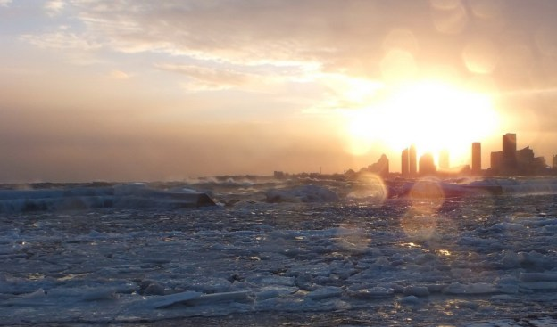 Icy waves breaking as the sunsets at Sunnyside on Lake Ontario in Toronto, Ontario, Canada
