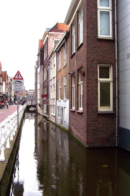 roadway and homes beside canal - delft - the netherlands