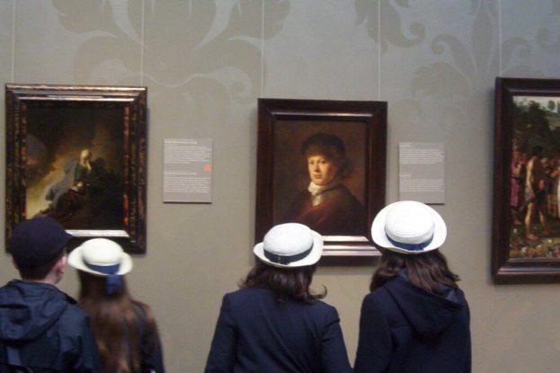 students look at portrait of rembrandt - rijksmuseum - amsterdam