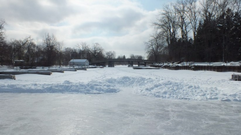 bridge over lagoon with skating rink - ward's island - toronto