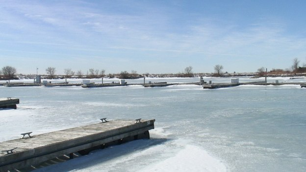 Boat docks in the frozen harbour at Colonel Samuel Smith Park in Etobicoke, Ontario, Canada