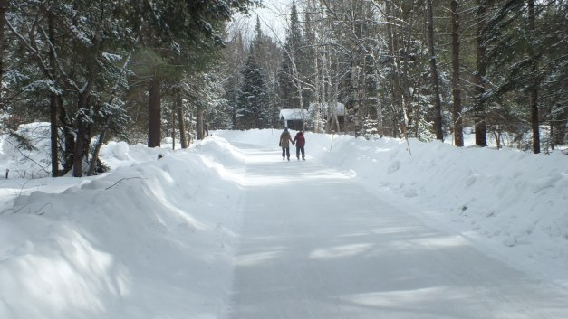People skating on the ice skating trail at Arrowhead Provincial Park near Huntsville, Ontario, Canada