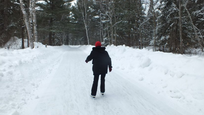 Jean skating on the ice skating trail at Arrowhead Provincial Park near Huntsville, Ontario, Canada
