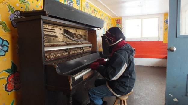 Jean playing the street piano at the Ward's Island Ferry Terminal in Toronto, Ontario