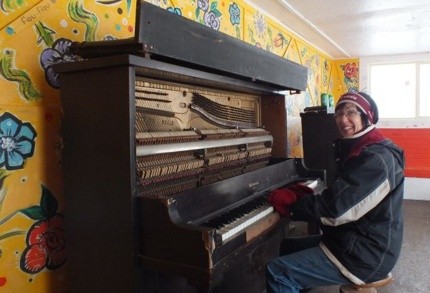 Jean plays the street piano at Ward's Island Ferry Terminal in Toronto, Ontario