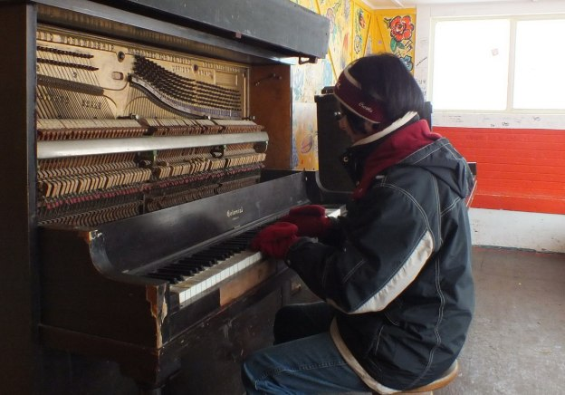 Jean playing a street piano at the Ward's Island Ferry Terminal in Toronto, Ontario