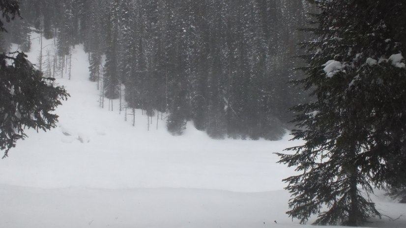 Snow blowing across Mirror Lake at Banff National Park, in Alberta, Canada
