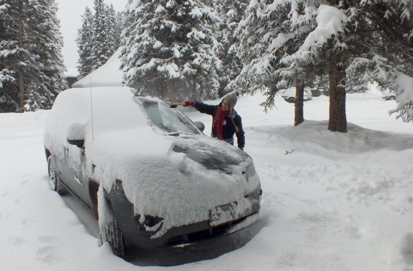 snow on car at lake louise inn - banff national park