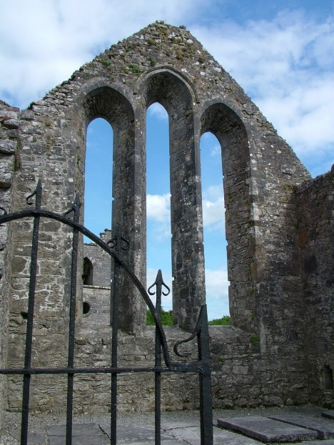 An image of the ruins of a stone windows at the Royal Abbey of Cong in Cong, County Mayo, Ireland.