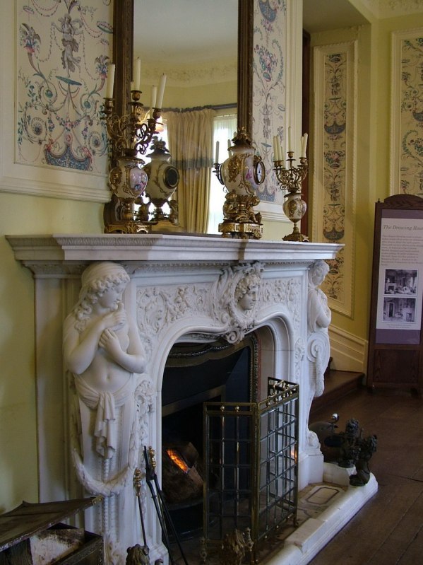 An image of a fireplace in Kylemore Abbey in Connemara, County Galway, Ireland. Photography by Frame To Frame - Bob and Jean.