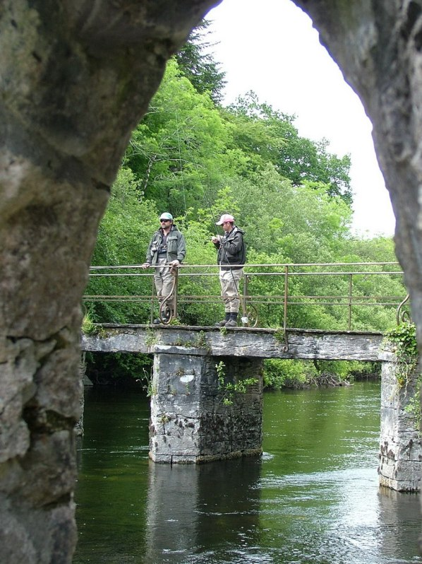 An image of fly fishermen on the Cong Canal bridge near the Royal Abbey of Cong, in Cong, Ireland. Photography by Frame To Frame - Bob and Jean.