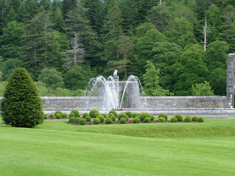 An image of the water fountain and gardens at Ashford Castle in County Mayo, Ireland. Photography by Frame To Frame - Bob and Jean.
