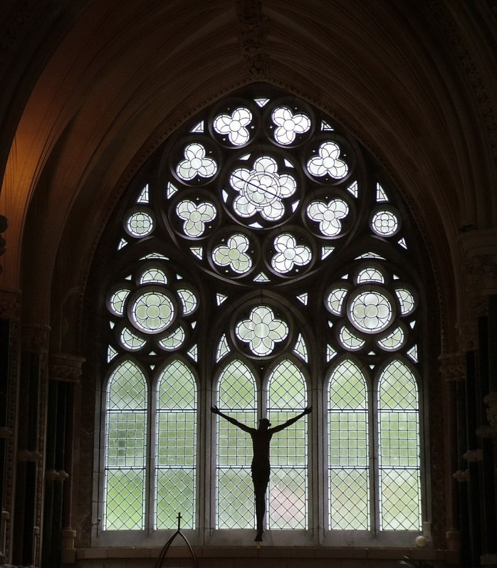 An image of a stain glass window in the Gothic Memorial Cathedral at Kylemore Abbey in Connemara, County Galway, Ireland. Photography by Frame To Frame - Bob and Jean.