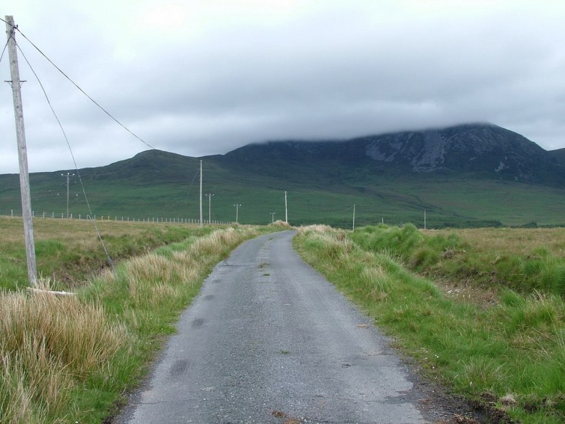 roadway towards bencullagh mountain - an chailleach - county galway - ireland