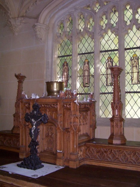 An image of the stein glass windows in the Chapel at Chateau de la Bourdaisiere in the Loire Valley, France.