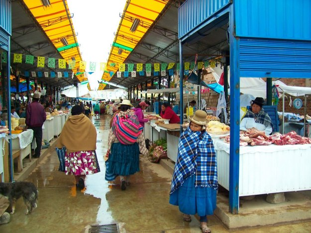 Indigenous native people in puno market - peru