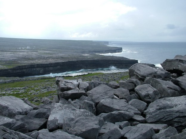 An image of the rugged Atlantic Ocean coastline near Dun Aonghasa Fort on Inishmore Island in Ireland. Photography by Frame To Frame - Bob and Jean.