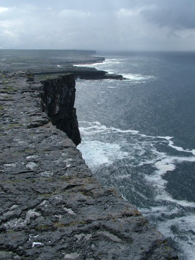 An image of the rugged Atlantic Ocean cliffs near Dun Aonghasa Fort on Inishmore Island in Ireland. Photography by Frame To Frame - Bob and Jean.