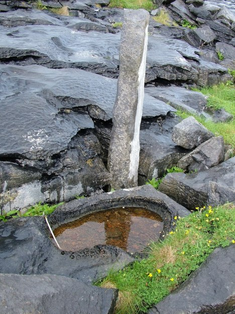 An image of water ponding on the rocks near Dun Aonghasa Fort on Inishmore Island in Ireland. Photography by Frame To Frame - Bob and Jean.