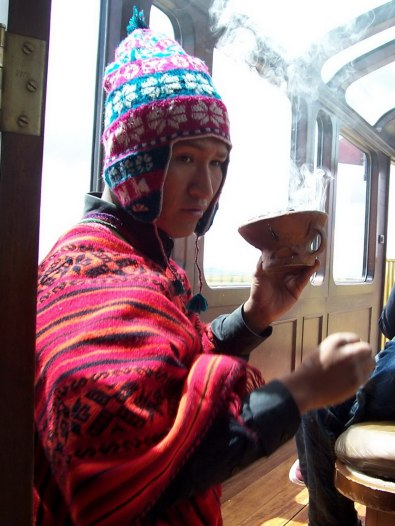 Shamon conducts the traditional Andean ceremony called Pago a la Tierra aboard the Andean Explorer train in Peru, South America