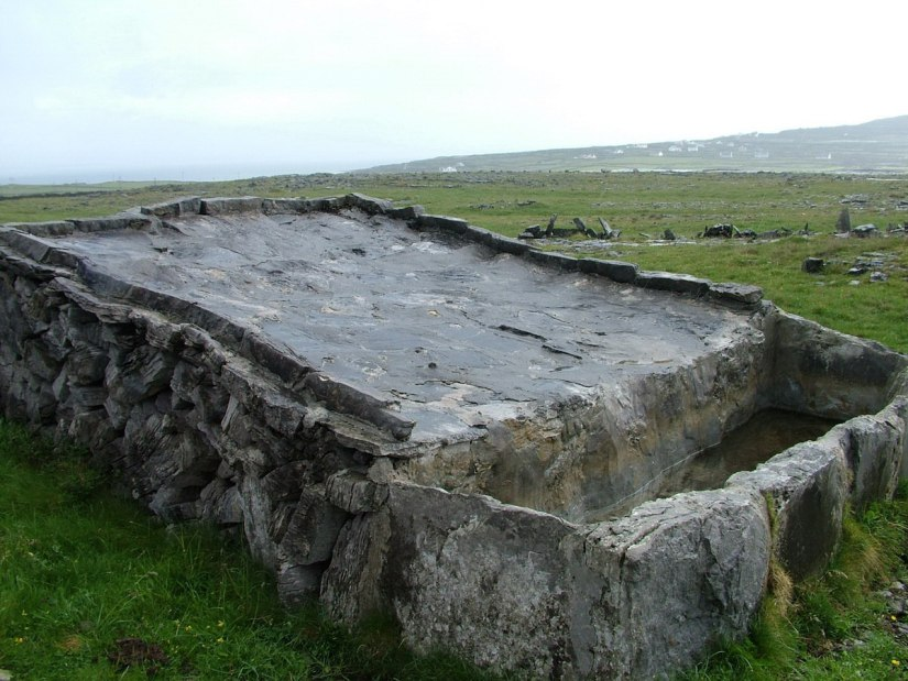 An image of a stone water trough near Dun Aonghasa Fort on Inishmore Island, in Ireland. Photography by Frame To Frame - Bob and Jean.