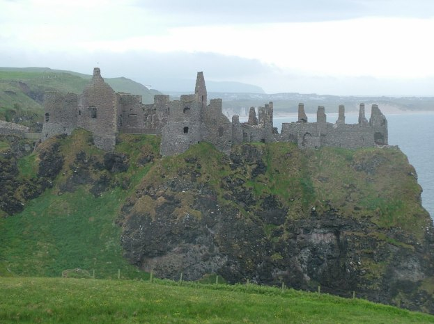 An image of the ruins of medieval Dunluce Castle on the coast of the North Atlantic in County Antrim, Northern Ireland. Photography by Frame To Frame - Bob and Jean.