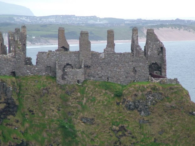 An image of the stone walls of Dunluce Castle on the coast of the North Atlantic in County Antrim, Northern Ireland. Photography by Frame To Frame - Bob and Jean.