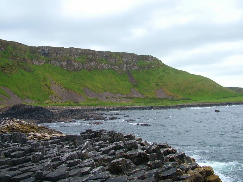 An image of the green hills and coastline at the Giant's Causeway, near Portrush, Northern Ireland. Photography by Frame To Frame - Bob and Jean.
