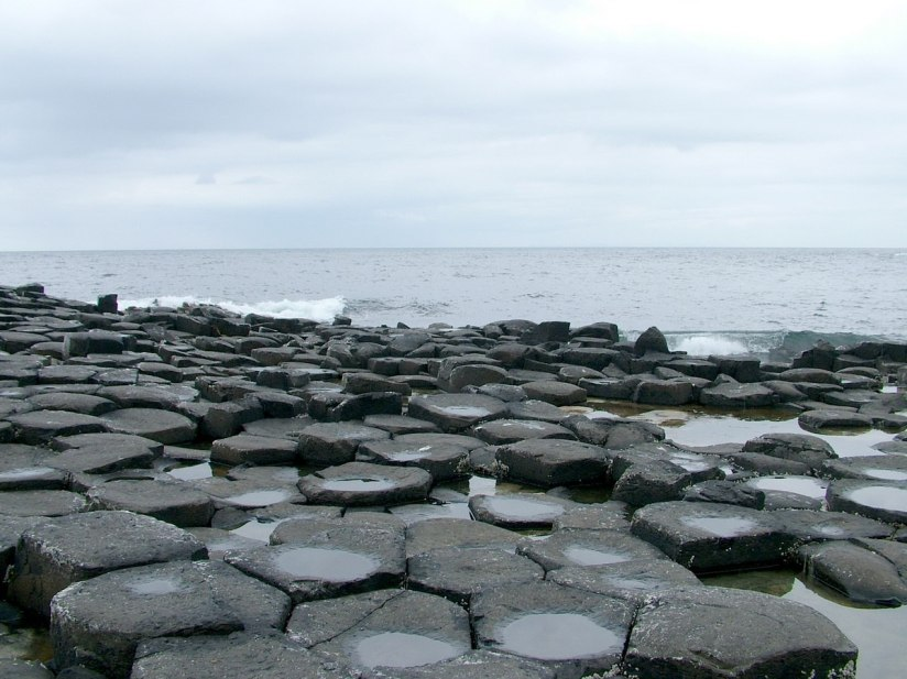 An image of the hexagonal basalt columns at the Giant's Causeway after rain, near Portrush, Northern Ireland. Photography by Frame To Frame - Bob and Jean.